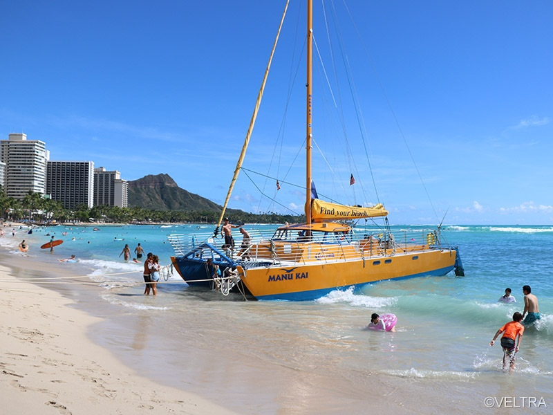 Leave busy Waikiki behind you and sail beyond Diamond Head