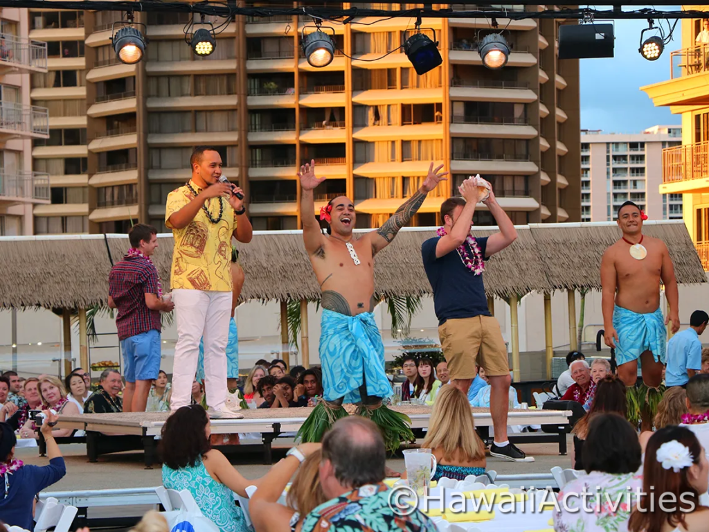 The audience dancing at the luau