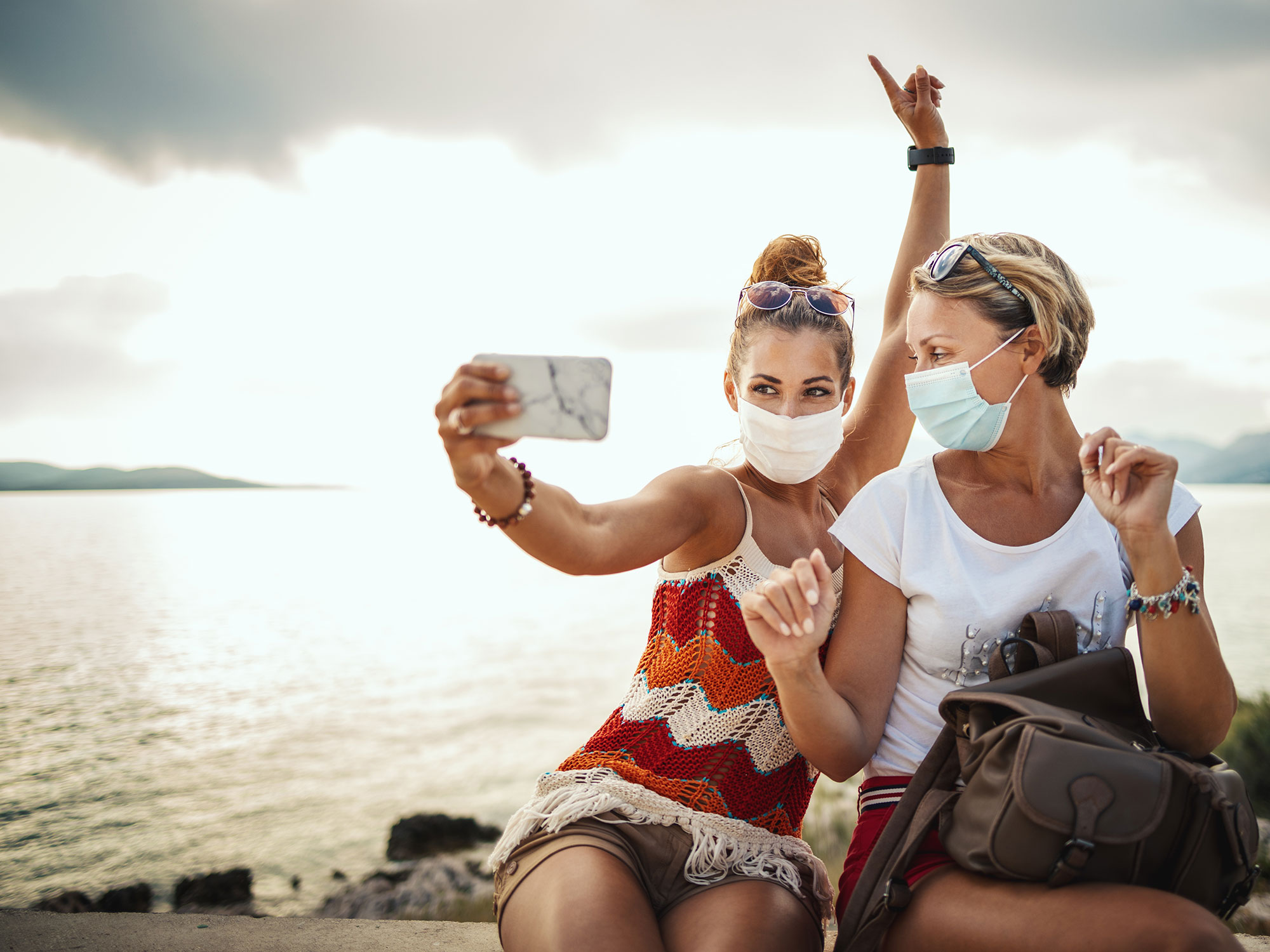 Two girls selfie with masks